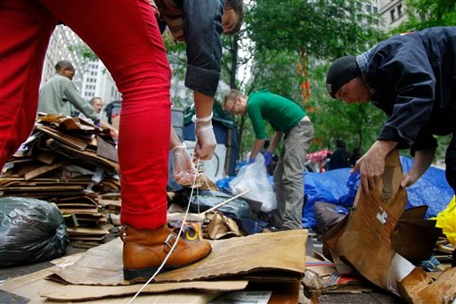 "Workgroups at Zuccotti Park's ""Occupy Wall Street"" encampment collect trash on Thursday, Oct. 13, 2011 in New York. (AP Photo/Bebeto Matthews)"
