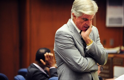 Defense Attorney J. Michael Flanagan makes a point as Dr. Conrad Murray, left, listens during Murray's involuntary manslaughter trial, Wednesday, Oct. 12, 2011, in downtown Los Angeles.