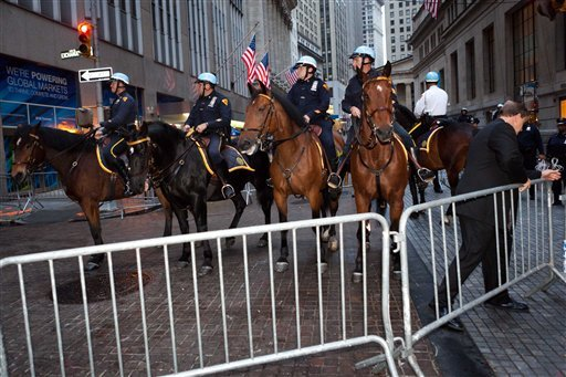 Mounted police officers prepare to defend Wall Street as hundreds of Occupy Wall Street protestors march on the financial district after being heartened by a postponement of a scheduled cleanup Oct. 14, 2011, in New York. (AP Photo/John Minchillo)