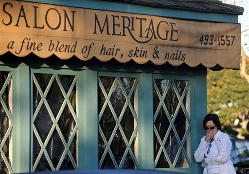 Janet Tedisco, of Seal Beach. Calif., cries in front of the site where eight people were killed and one was wounded in a shooting at Salon Meritage on Thursday, Oct. 13, 2011, in Seal Beach. (AP Photo/Chris Carlson)