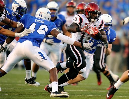 San Diego State running back Ronnie Hillman (13) breaks out of the grasp of Air Force linebacker Jamil Cooks (46) for a first down in the first quarter of an NCAA college football game, Thursday, Oct. 13, 2011, in Air Force Academy, Colo.