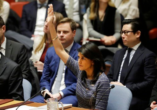 U.S. Ambassador Nikki Haley votes in favor of a resolution, Friday, Dec. 22, 2017, at United Nations headquarters. (AP Photo/Mark Lennihan)