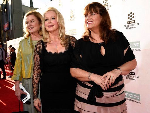 """FILE - In this March 26, 2015, file photo, Heather Menzies-Urich, from left, Kym Karath and Debbie Turner, cast members in the classic film """"The Sound of Music,"""" pose together before a 50th anniversary screening of the film. (Photo by Chris Pizzello/Invis"""