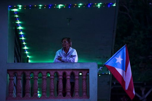 Government officials say they are counting some suicides as part of the official death toll because people across Puerto Rico have become so desperate in post-hurricane conditions. (AP Photo/Carlos Giusti)