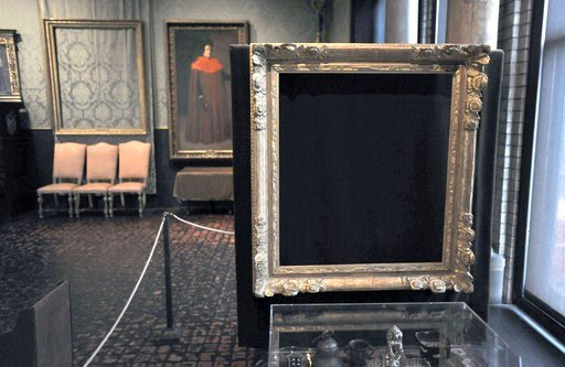 "FILE - In this March 11, 2010, file photo, empty frames from which thieves took ""Storm on the Sea of Galilee,"" left rear, by Rembrandt and ""The Concert,"" right foreground, by Vermeer, remain on display at the Isabella Stewart Gardner Museum in Boston. (AP"