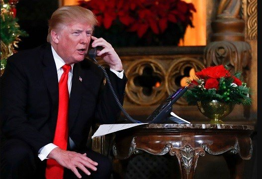 President Donald Trump speaks on the phone with children as they track Santa Claus.