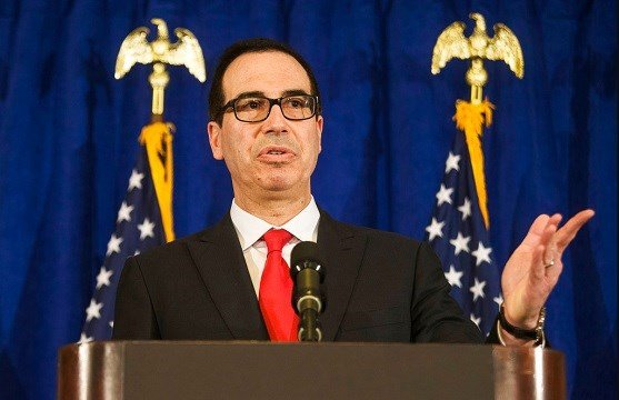 Treasury Secretary Steve Mnuchin speaks at a news briefing at the Hilton Midtown hotel in New York.
