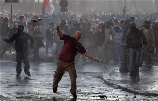 Protesters hurl objects at police in Rome, Saturday, Oct. 15, 2011. (AP Photo/Gregorio Borgia)