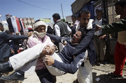 Anti-government protestors carry a wounded protestor from the site of clashes with security forces, in Sanaa, Yemen, Saturday, Oct. 15, 2011. (AP Photo/Hani Mohammed)