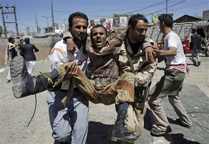 Anti-government protestors carry a wounded defected army soldier from the site of clashes with security forces, in Sanaa, Yemen, Saturday, Oct. 15, 2011. (AP Photo/Hani Mohammed)
