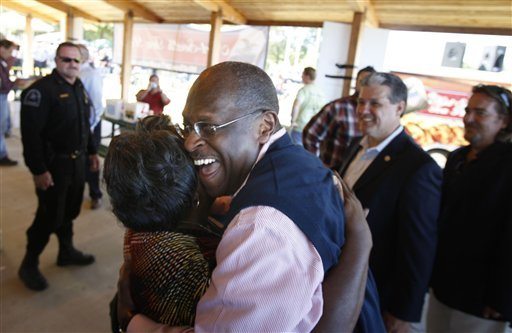 Herman Cain hugs his half sister Myrlean Taylor of Eads after giving a speech in Bartlett, Tenn. Friday, October 14, 2011. (AP Photo/The Commercial Appeal, Karen Pulfer Focht)