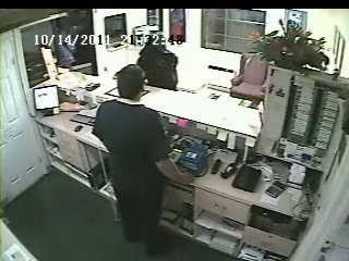 Surveillance video of an employee of the owner of Roadway Inn and the attempted robbery suspect on October 14, 2011.