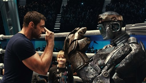"This file image provided by Disney/DreamWorks II shows Hugh Jackman, left, and Dakota Goyo in a scene from ""Real Steel."" (AP)"