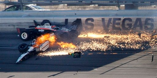 Drivers Dan Wheldon, front, and Will Power crash during a wreck that involved 15 cars during the IndyCar Series' auto race at Las Vegas Motor Speedway in Las Vegas on Sunday, Oct. 16, 2011. (AP)