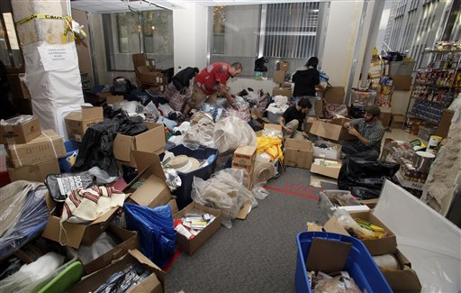Volunteers organize supplies that fill an unused storage space donated by the United Federation of Teachers to support the camp of Occupy Wall Street protesters in New York, Sunday, Oct. 16, 2011. (AP Photo/David Karp)