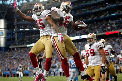 San Francisco 49ers tight end Delanie Walker (46) celebrates his fourth-quarter touchdown with wide receiver Michael Crabtree (15) to take the lead in an NFL football game against the Detroit Lions, Sunday, Oct. 16, 2011, in Detroit. (AP)