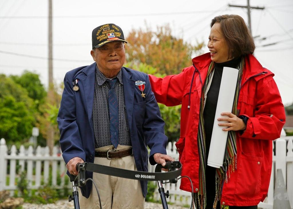 In this Thursday, April 6, 2017 file photo, Bataan Death March survivor Ramon Regalado walks with Cecilia Gaerlan outside his home in El Cerrito, Calif. (AP Photo/Eric Risberg,File)