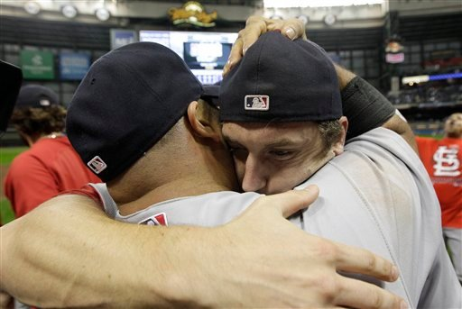 St. Louis Cardinals' Albert Pujols, left, hugs David Freese as they celebrate after Game 6 of baseball's National League championship series against the Milwaukee Brewers Sunday, Oct. 16, 2011, in Milwaukee. (AP)