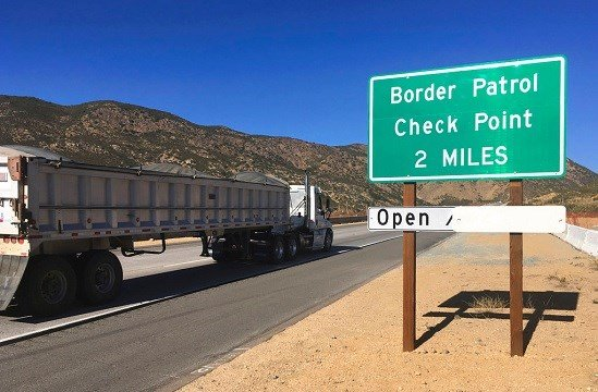 A sign warns of the upcoming California Pine Valley checkpoint, on the main route from Arizona to San Diego.
