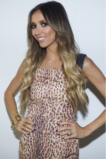 """FILE - In a Monday, Sept. 12, 2011 file photo, """"E! News"""" co-host Giuliana Rancic attends the Rachel Zoe Spring 2012 fashion show during Mercedes-Benz Fashion Week in New York."""