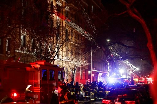 Firefighters respond to a building fire Thursday, Dec. 28, 2017, in the Bronx borough of New York. The Fire Department of New York says a blaze raging in the Bronx apartment building has seriously injured more than a dozen of people. (AP Photo/Frank Frank