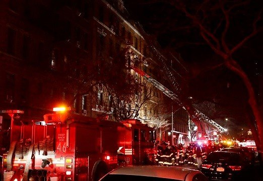 Firefighters respond to a building fire Thursday, Dec. 28, 2017, in the Bronx borough of New York.
