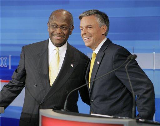 Republican presidential candidates businessman Herman Cain, left, and former Utah Gov. Jon Huntsman, get together prior to a debate Thursday, Sept. 22, 2011, in Orlando, Fla. (AP Photo/John Raoux)