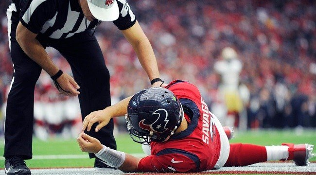 Houston Texans quarterback Tom Savage (3) is checked by a referee after he was hit during the first half of an NFL football game.