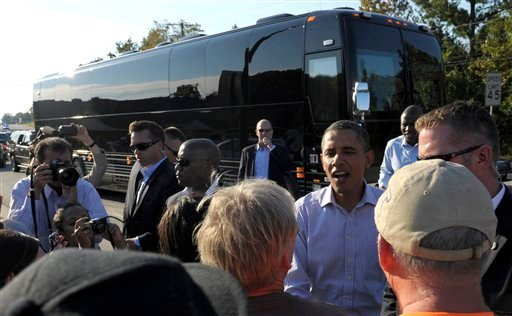 President Barack Obama stops to visit with people on the side of the road in Brodnax, Va, Tuesday, Oct. 18, 2011. Obama is on a three-day bus tour promoting the American Jobs Act.