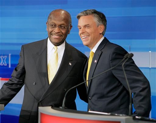 Republican presidential candidates businessman Herman Cain, left, and former Utah Gov. Jon Huntsman, get together prior to a debate Thursday, Sept. 22, 2011, in Orlando, Fla.