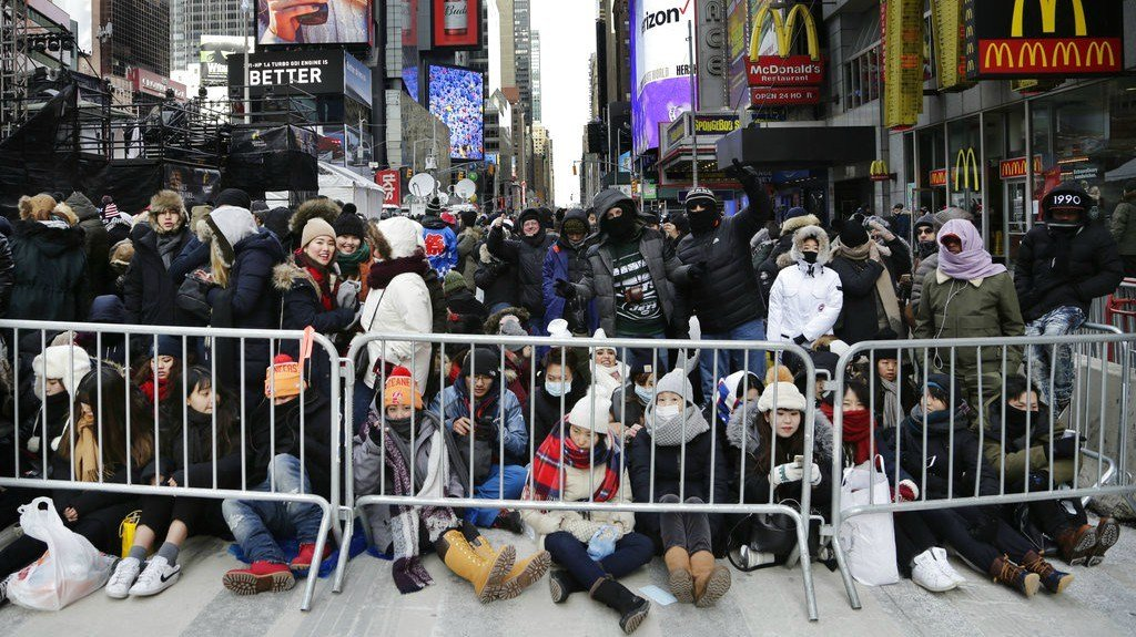 Spectators gather ahead of the New Year's Eve celebration in Times Square in New York, on Sunday, Dec. 31, 2017. (AP Photo/Peter Morgan)