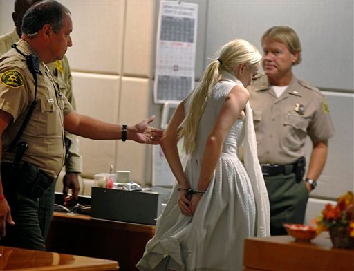 Lindsay Lohan is taken into custody by Los Angeles Country sheriffs after a judge finds her in violation of probation Wednesday, Oct. 19, 2011, in Los Angeles.