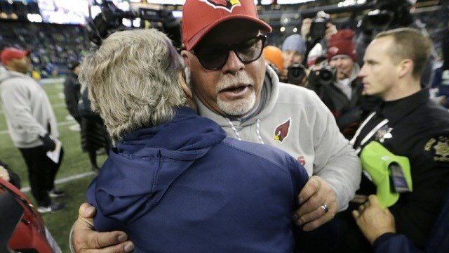 Arizona Cardinals head coach Bruce Arians, front right, hugs Seattle Seahawks head coach Pete Carroll, left, after an NFL football game, Sunday, Dec. 31, 2017, in Seattle.