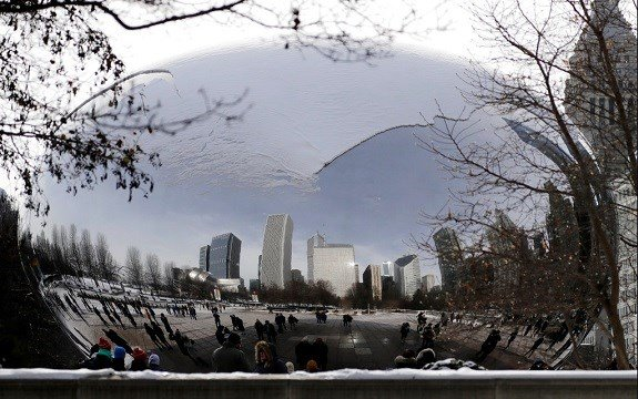 People visit a snow-covered Cloud Gate at Millennium Park in Chicago.