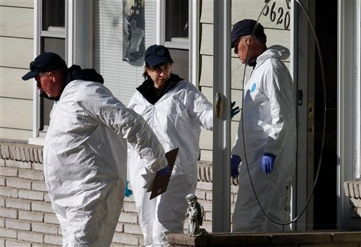 Investigators leave the home of missing baby Lisa Irwin in Kansas City, Mo., Wednesday, Oct. 19, 2011.
