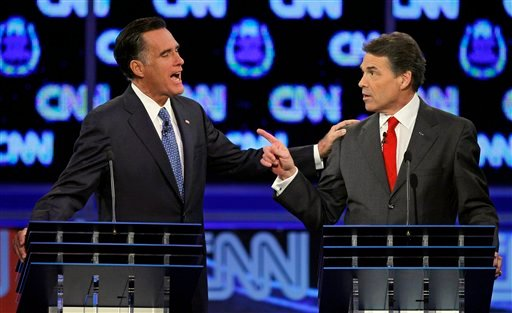 Republican presidential candidates former Massachusetts Gov. Mitt Romney, left, and Texas Gov. Rick Perry speak during a Republican presidential debate Tuesday, Oct. 18, 2011, in Las Vegas.