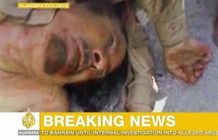 This image made available by the Al Jazeera television channel, claims to show former Libyan leader Muammar Qaddafi, after he was killed at an undisclosed location in Libya Oct. 20, 2011. (AP Photo/Al Jazeera)