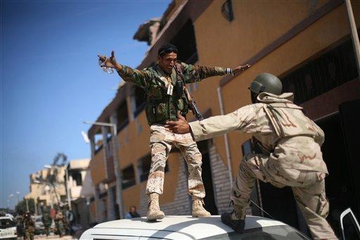 Revolutionary fighters celebrate the capture of Sirte, Libya, Thursday, Oct. 20, 2011.