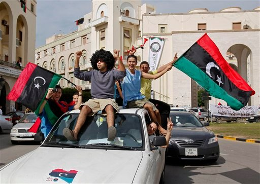 Libyans celebrate Muammar Qaddafi's death in Tripoli, Libya, Thursday, Oct. 20, 2011.
