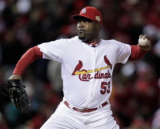 St. Louis Cardinals relief pitcher Arthur Rhodes throws during the eighth inning of Game 1 of baseball's World Series against the Texas Rangers Wednesday, Oct. 19, 2011, in St. Louis. (AP Photo/Charlie Riedel)