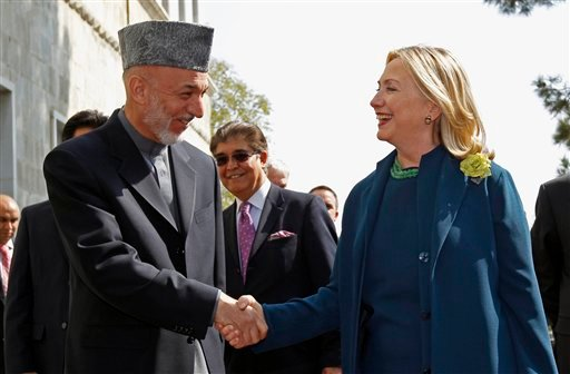 U.S. Secretary of State Hillary Rodham Clinton meets with Afghan President Hamid Karzai at the Presidential Palace in Kabul, Afghanistan Oct. 20, 2011. (AP Photo/Kevin Lamarque, Pool)