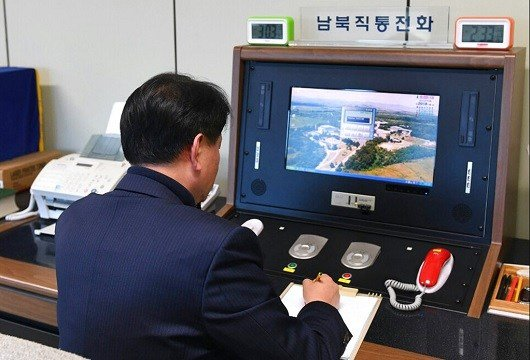 A South Korean government official checks the direct communications hotline to talk with the North Korean.