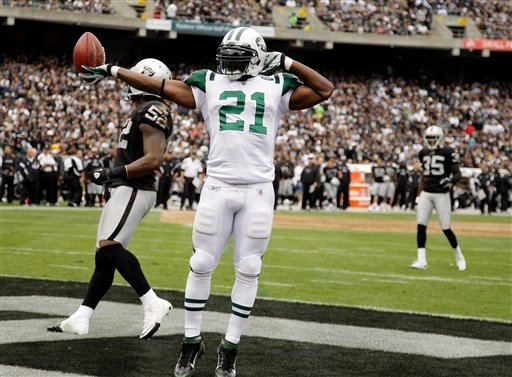 New York Jets running back LaDainian Tomlinson (21) celbrates in the end zone after an 18-yard touchdown reception against the Oakland Raiders.