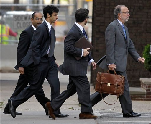 Dharun Ravi, second from left, walks out of the Middlesex County Courthouse with his attorneys after a hearing in the webcam-spying case involving the suicide of Rutgers University student Tyler Clementi, Thursday, Oct. 20, 2011, in New Brunswick, N.J.