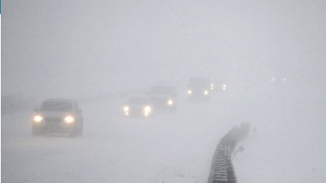 Vehicles commute southbound on the Garden State Parkway in whiteout conditions during a snowstorm in Eatontown, N.J.