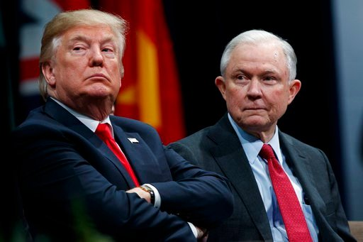 President Donald Trump sits with Attorney General Jeff Sessions during the FBI National Academy graduation ceremony, Friday, Dec. 15, 2017, in Quantico, Va. (AP Photo/Evan Vucci)