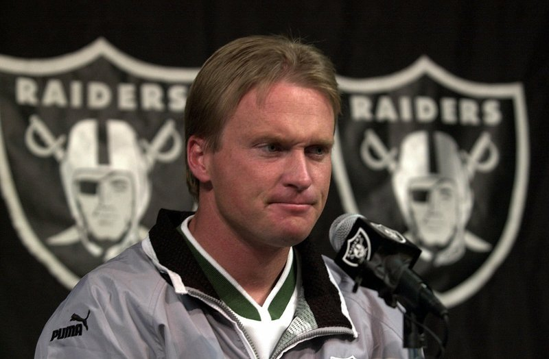 In this Jan. 14, 2001, file photo, then-Oakland Raiders' coach Jon Gruden is shown during a press conference at Raiders headquarters in Alameda, Calif.