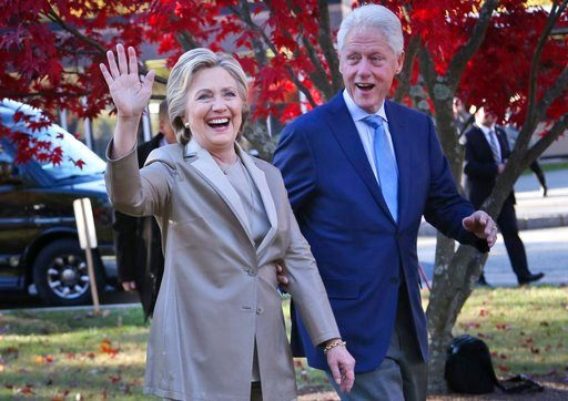 FILE - In this Nov. 8, 2016, file photo, then-Democratic presidential candidate Hillary Clinton, and her husband former President Bill Clinton, greet supporters after voting in Chappaqua, N.Y.  (AP Photo/Seth Wenig, File)