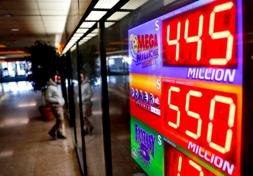 A sign advertises Powerball and Mega Millions lottery jackpots at a store in Atlanta, Thursday, Jan. 4, 2018. An estimated $550 million jackpot is up for grabs on Saturday night's Powerball lottery drawing, making it potentially the 8th largest prize in t