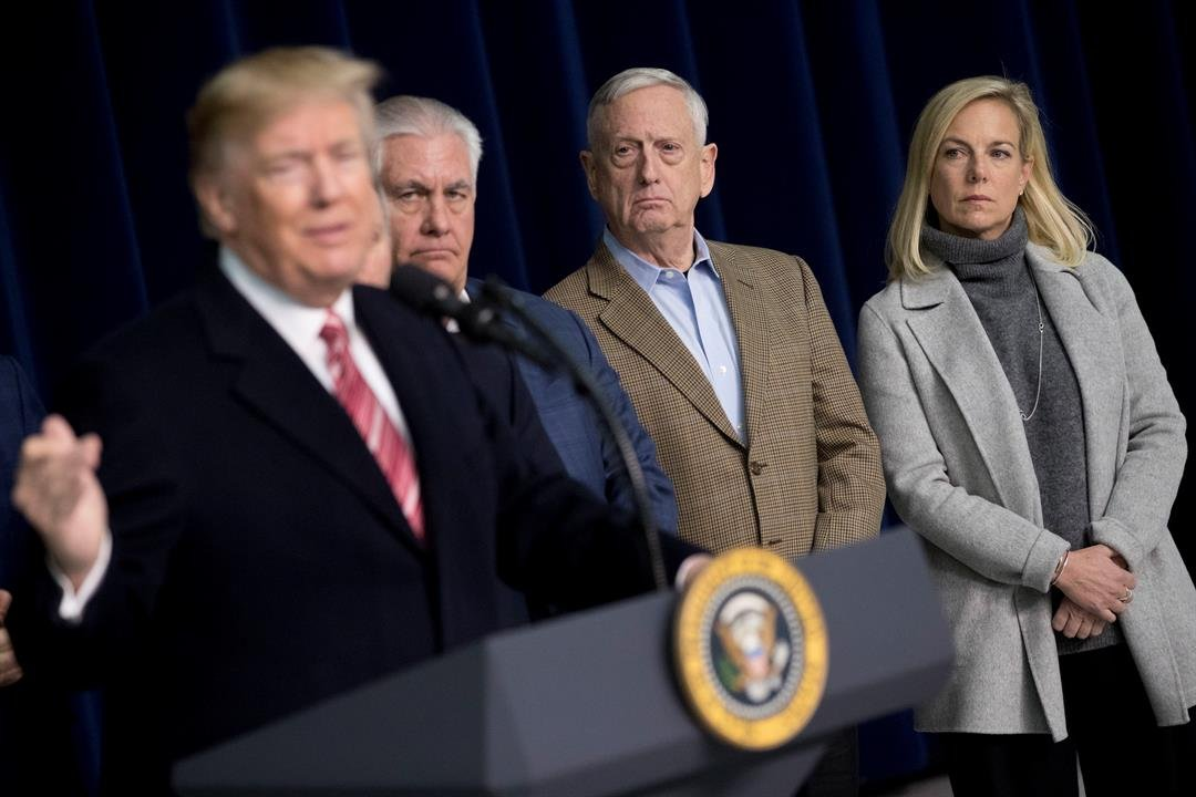 From left, President Donald Trump, accompanied by Secretary of State Rex Tillerson, Defense Secretary Jim Mattis, and Secretary of Homeland Security Kirstjen Nielsen, speaks to members of the media after participating in a Congressional Republican Leaders